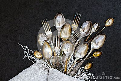 Forks and spoons on the stone background