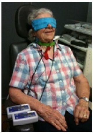Figure 1 Patient receiving microcurrent treatment.