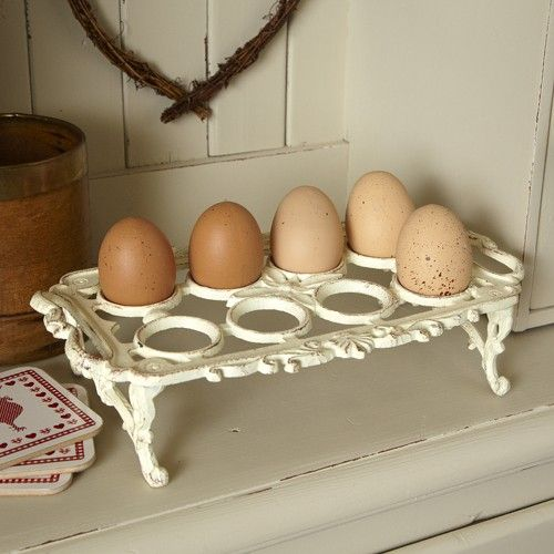 In true victorian kitchen style this cast iron egg holder holds 8 eggs. Keep them at hand whilst cooking with this pretty and practical piece. This egg holder has flowing scroll work and its distressed cream colour makes it very decorative.The perfect country kitchen accessory that has a timeless appeal.