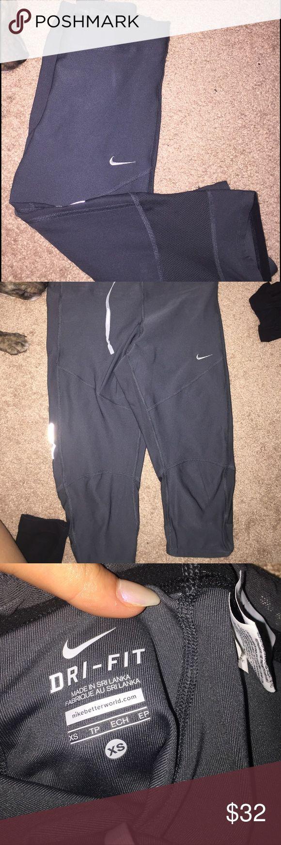 Crop DRI-FIT Nike leggings Worn once Nike dri-fit grey leggings size XS!!!(ignore my puppy) Nike Pants Leggings