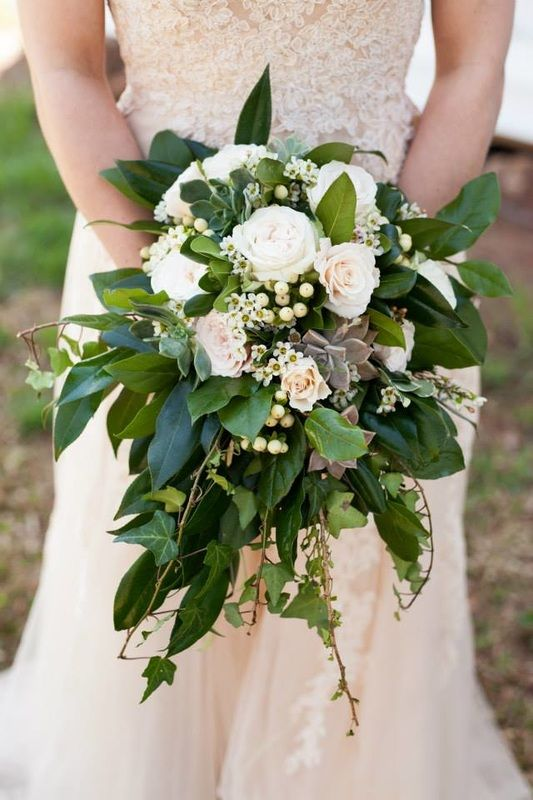 "Tara's beautiful wedding bouquet of roses, succulents, hypericum berries, wax flower, ivy, salal and camellia leaves.  Most of the greenery was cut from our yard and the succulents were grown by ""Nana"". bouquet made by @roxiecrainseale  photo by: @lettersandlight"