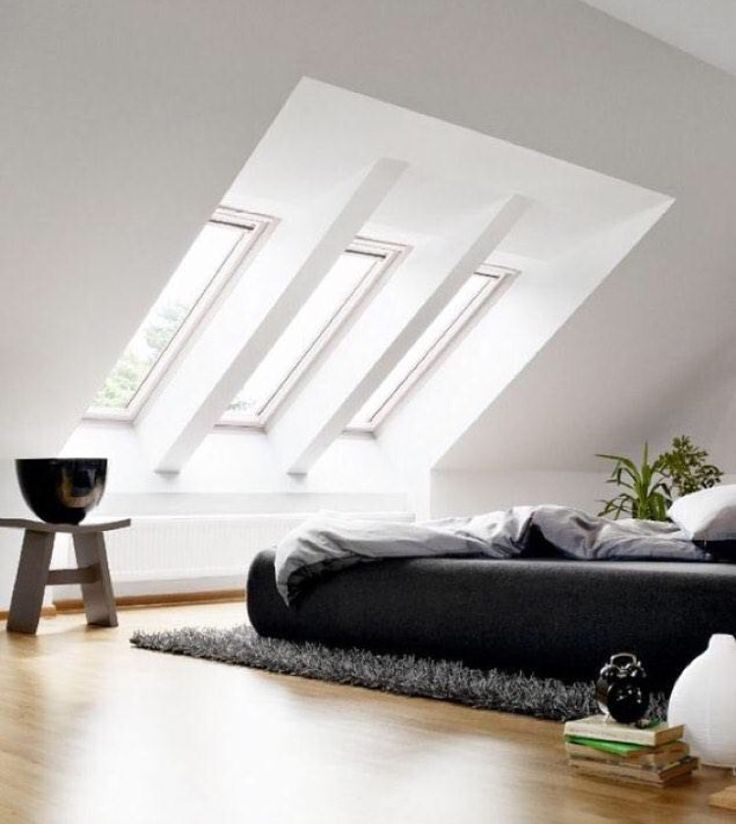 Love turning an attic too a sophisticated bedroom