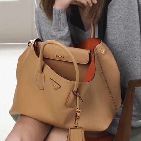 Prada unveils new Double Bag for Spring 2014. www.handbag.com
