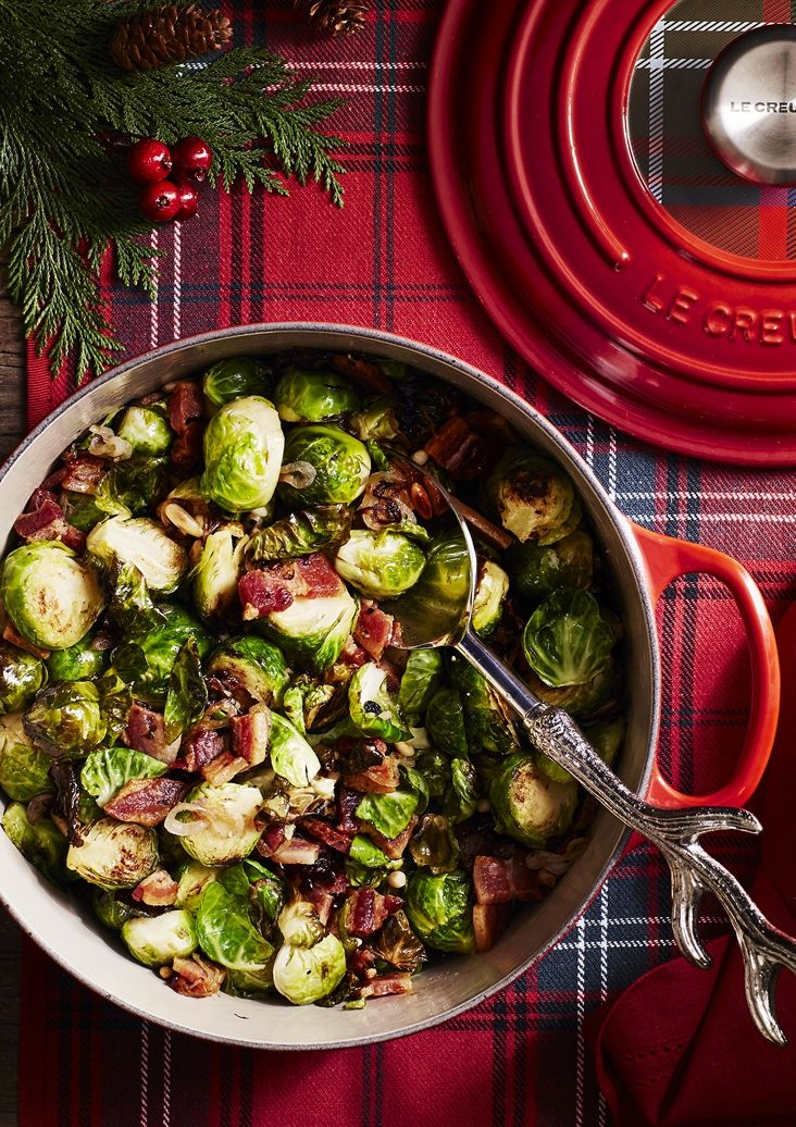 Roasted Brussels Sprouts with Pine Nuts and Bacon | Slivers of crisp bacon add salty and savory notes to brussels sprouts in this easy side dish.
