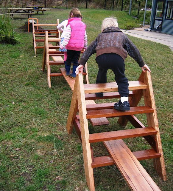 "Hm... climbing frames and planks.   Not terribly ""natural"", but it's something the kids would get a lot of use out of. And could be extra seating when they run outside with a snack..."