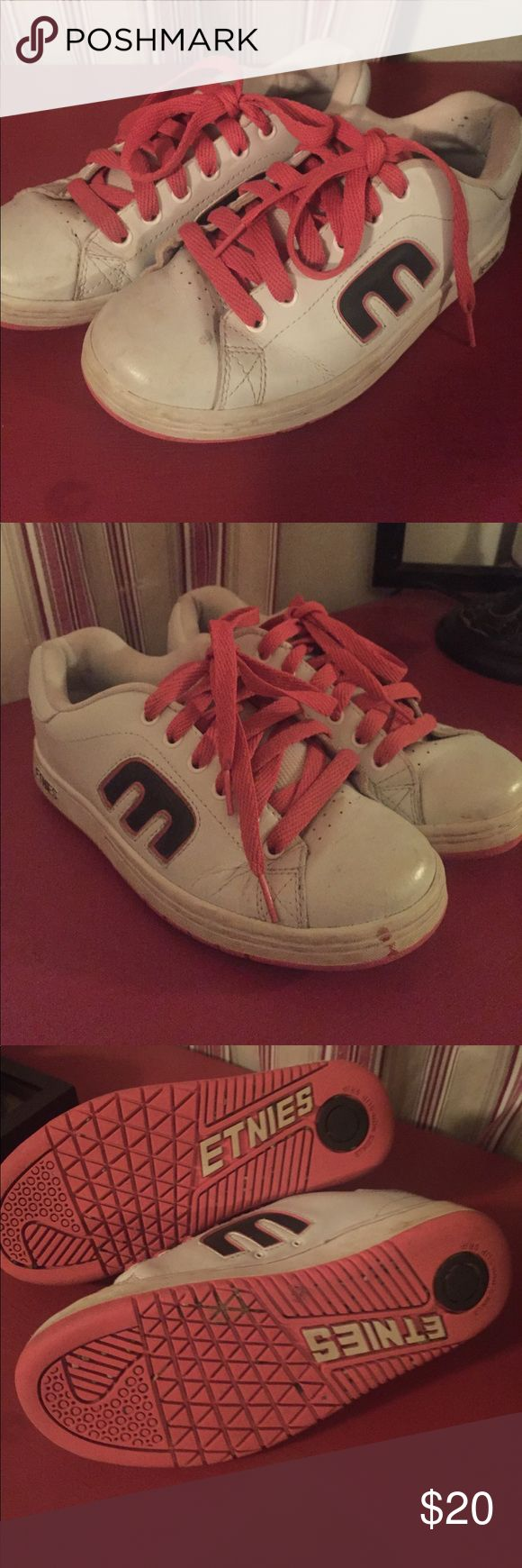 Pink and white Etnies skate shoe Size 7.5 women's Etnies skate shoe. White shoe with pink laces. In used condition but lots of life left. Etnies Shoes Athletic Shoes