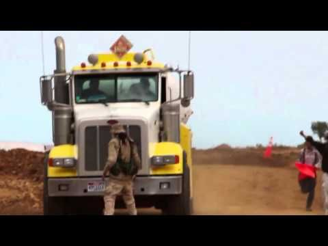 Nonviolent Direct Action Shuts Down First US Tar Sands Mine in Utah - YouTube - HOORAY!!