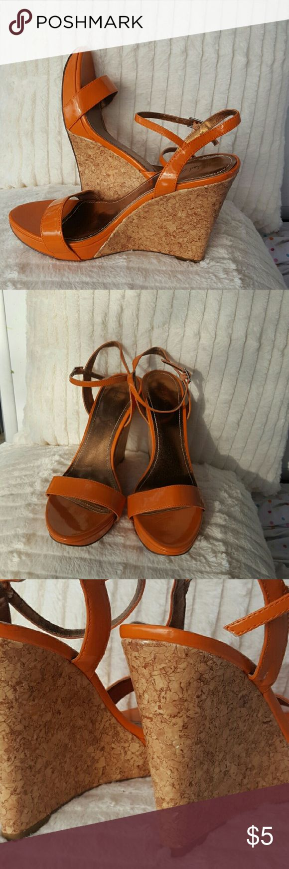 Nine west Orange strap wedges. Worn 2 times Good condition. They are a shiny orange with a cord wedge .  They do have one scuff on the cork and one white scuff on the  right orange strap. Will add to any bundle for $3 Nine West Shoes Wedges