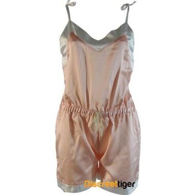 The Phialli silky romper playsuit is the perfect one peice for going out or lazing about in. Vintage-inspired champagne pink with thin delicate tie up straps, drawstring waistband and contrasting pearl white wide trim. It's so soft and silky you won't want to take this piece off. Petite to Plus size.