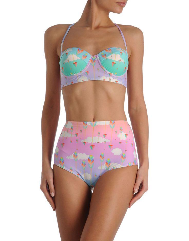 A collection of Swimwear byDiana Auria Harris beachwear uses ECONYL®, a recycled nylon yarn. www.econyl.com