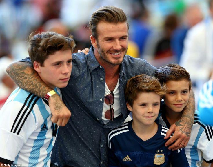 Family outing: David Beckham and his three sons Brooklyn, Cruz and Romeo