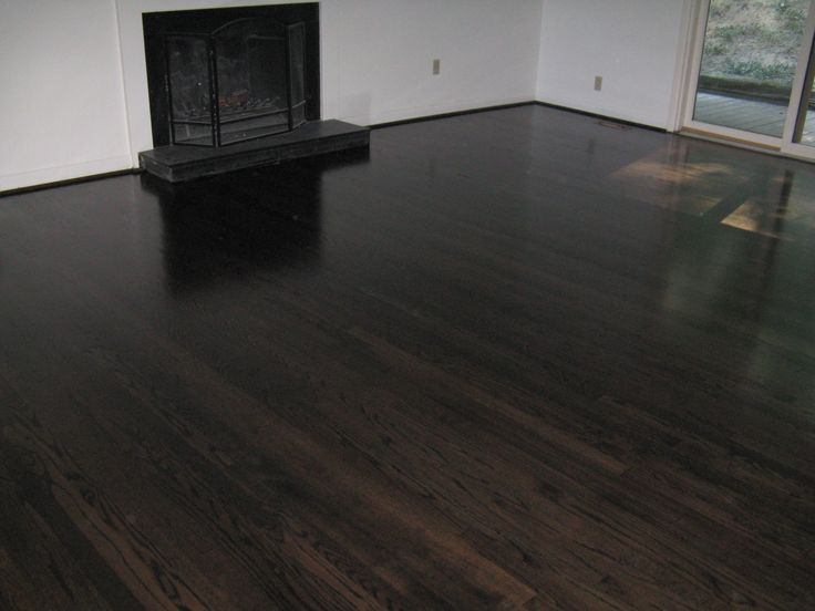 "5"" red oak stained black/ebony throughout first floor"