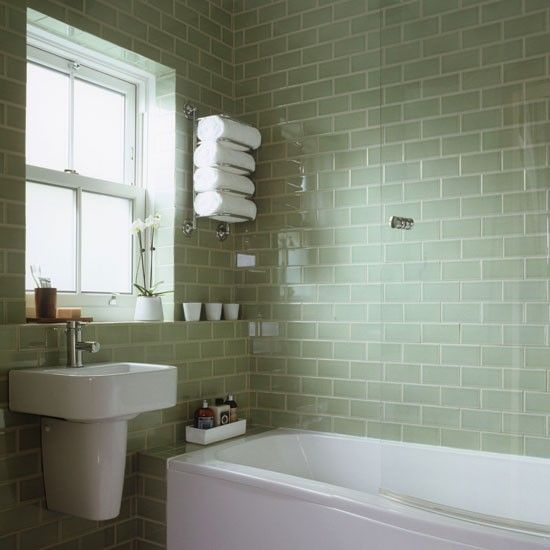 Glossy tiles in a muted shade will reflect light, making the room brighter and giving the overall impression of a bigger space.  They also have the added advantage of making the space look clean and shiny (provided you wipe them down often!).