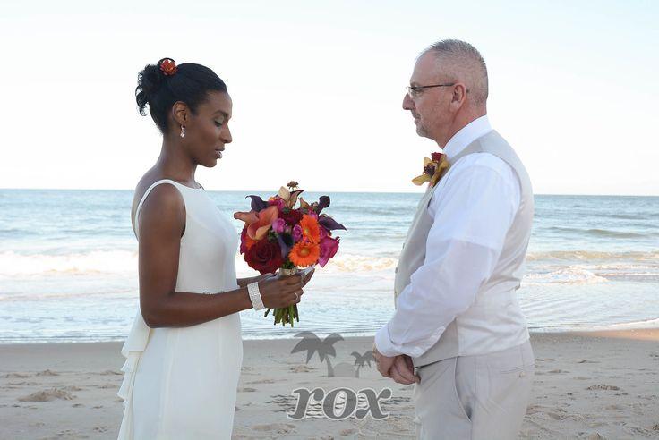 Eloping couple exchange wedding vows on the Bethany DE beach: https://www.roxbeachweddings.com/