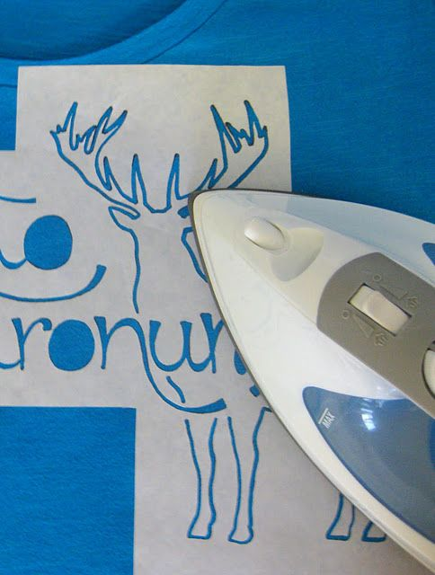 use freezer paper to create a stencil, iron it on and stencil on fabric paint with a stiff brush. pull off your stencil and wait for it to dry.