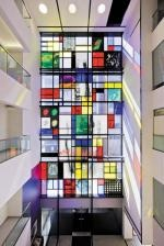 Walk into the Baker IDI Heart and Diabetes Institute, a centre for medical research in Melbourne. You enter an atrium with a four-storey high window, which is divided, on the pattern of a Mondrian painting, into coloured and clear rectangles of glass.