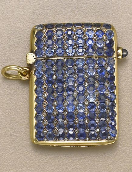 An antique sapphire, diamond and gold match safe, French, circa 1890 the front pavé-set with hexagonal-cut sapphires and rose-cut diamond detail, reeded texture to reverse, hinged lid with cabochon sapphire lever; with French assay marks, numbered 29073; estimated total sapphire weight 5.20 carats; dimensions: 1 3/8 x 1 in.