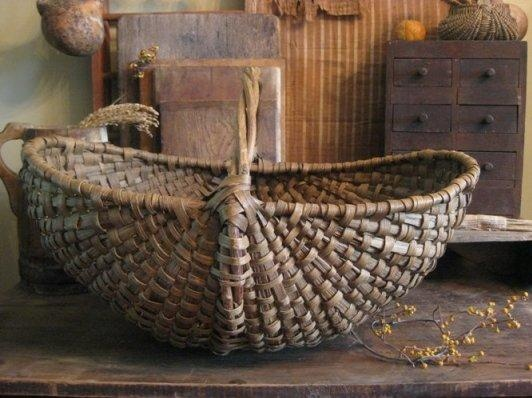 I have this same primitive basket...think Ill use it for fall decorating on my table.
