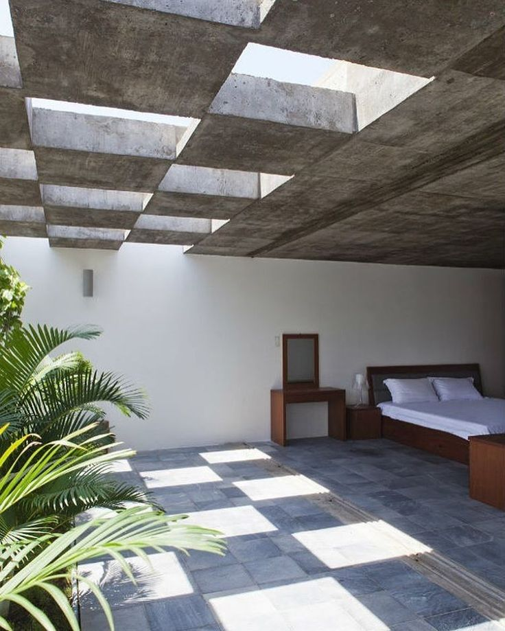 Natural light and ventilation go hand-in-hand with mellow greenery to make this Vietnamese retreat optimal for relaxing and taking it easy. Vo Trong Nghia Architects conceived a design suitable for a modern and well-tempered lifestyle that takes advantage of Vietnam's sunny tropical climate. #architecture #interiors #design #interiordesign #house #vietnam... - Interior Design Ideas, Interior Decor and Designs, Home Design Inspiration, Room Design Ideas, Interior Decorating, Furniture And…