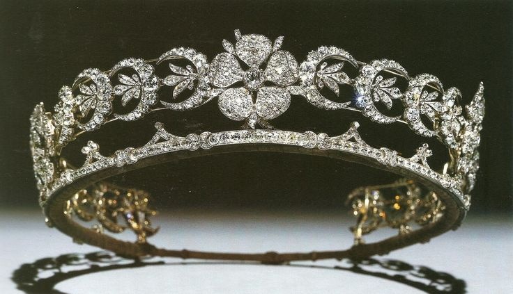 The Teck Crescent Tiara came into the British royal family by way of Queen Mary's mother, Princess Mary Adelaide, the Duchess of Teck. This diamond diadem, featuring three wild roses separated by 20 crescent shapes, was assembled by Mary Adelaide from various jewels she inherited from her aunt, Princess Mary, Duchess of Gloucester.