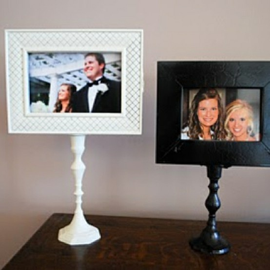 Homemade picture stands. Take a candle stick and hot glue the photo onto it.
