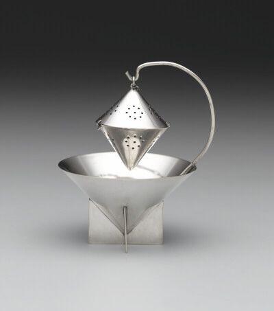 Paye & Baker Manufacturing Co.  North Attleboro, Massachusetts, active 1901 – 1935    Ilonka Karasz, American, 1896 – 1981    Tea ball and stand, 1928  Silverplate