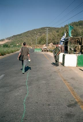 Francis Alys recreating a political border between Israel and Jordan.