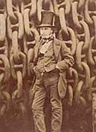 Isambard Kingdom Brunel against the back drop of huge shipping chains.