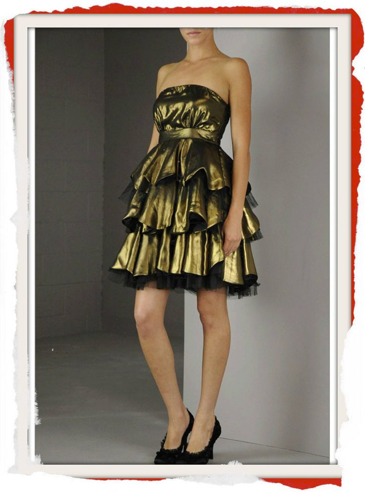 Classic Black Tulle over gold, strapless tiered formal dress with tulle underlay for a full effect. $99 info@fashionjazz.com.au