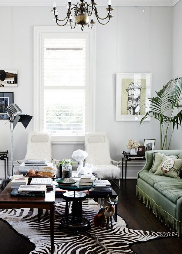 soft green couch + animal hide rug #smallspaces