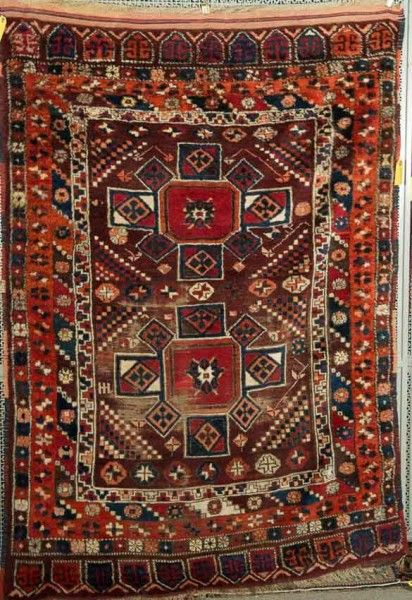 Lot 711. TURKISH VILLAGE RUG, 19th century; 6 ft. x 4 ft. 2 in.  Grogan's June Sale including rugs and carpets 8 June 2014
