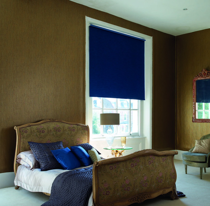 Luxury Blackout blue roller blind tied in with matching bed cushions and throw