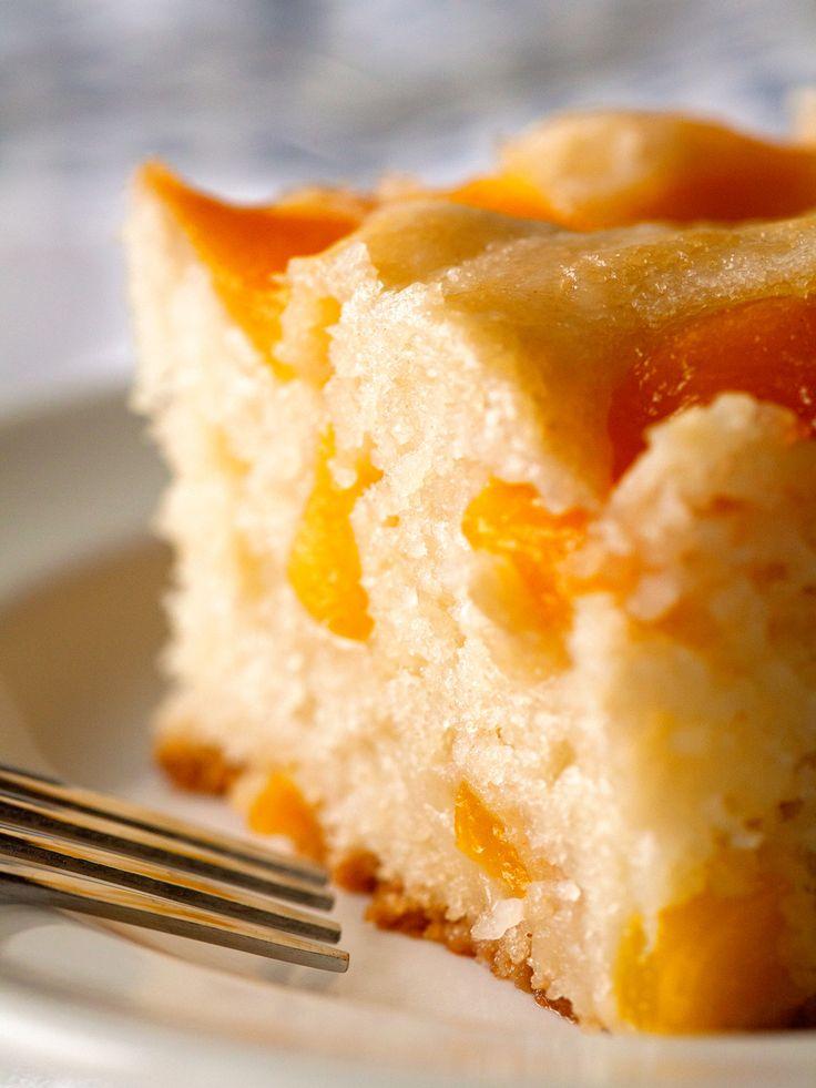 Peach Cobbler Snack Cake Need: 1 C granulated sugar plus 3 tsp, divided; 2 1/2 C sliced peaches; 1/2 tsp corn starch; 2 C flour; 1/2 tsp salt; 2 1/2 tsp baking powder; 1 1/2 C whole milk; 3 tbsp unsalted butter, melted.