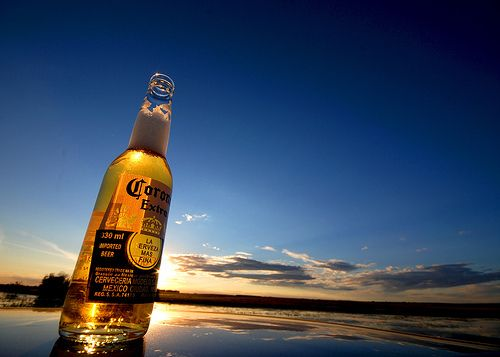 Beer corona at the beach alcohol drink bottle. No I don't like corona to much. But I LOVE the IDEA drinking on a BEAUTIFUL BEACH & the corona commercial.