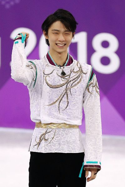 Yuzuru Hanyu Photos - Gold medal winner Yuzuru Hanyu of Japan celebrates during the victory ceremony for the Men's Single Free Program on day eight of the PyeongChang 2018 Winter Olympic Games at Gangneung Ice Arena on February 17, 2018 in Gangneung, South Korea. - Figure Skating - Winter Olympics Day 8