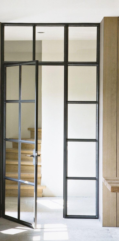Black frame interior doorway with pale oak stairway