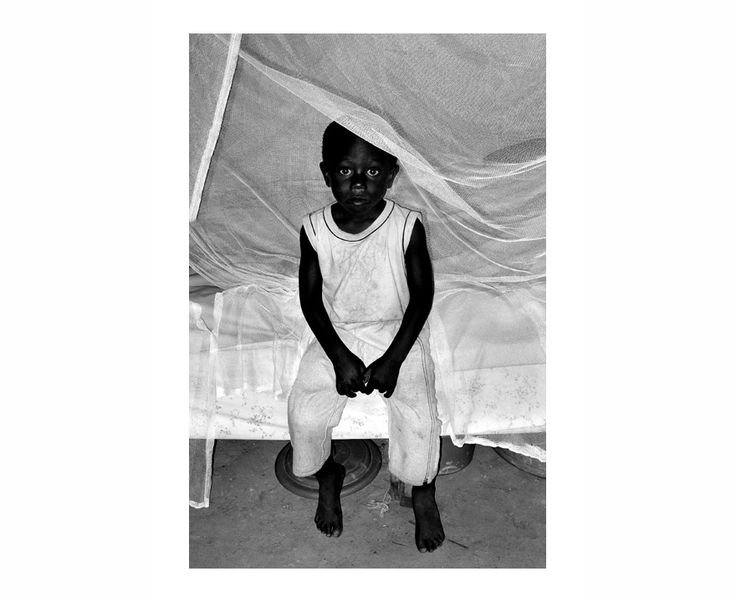 Reflejos del Alma | South Wind Pictures Young Boy from the flooded Rundu Area, Namibia 2010