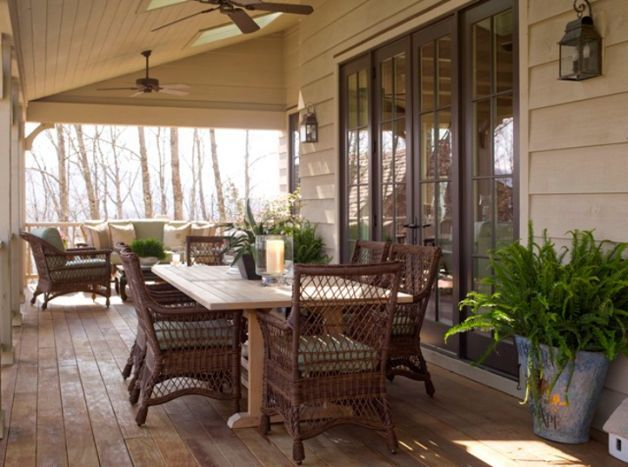 light weight cane chairs /big table on covered porch