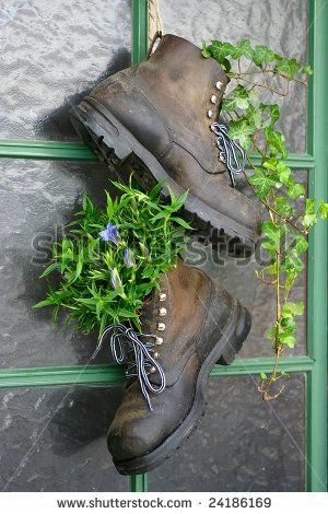 mountain home entrance | Old mountain boots used as flower pots on the entrance door of a house ...