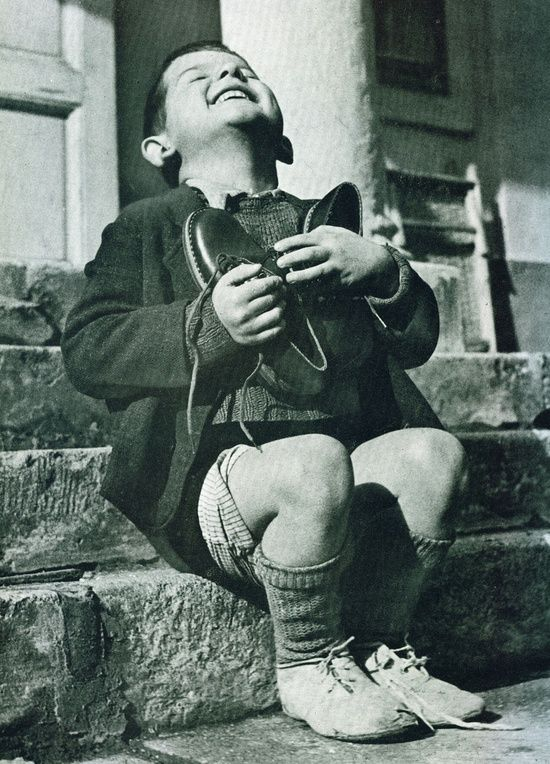I can never look at this photo of a young European boy receiving a new pair of…