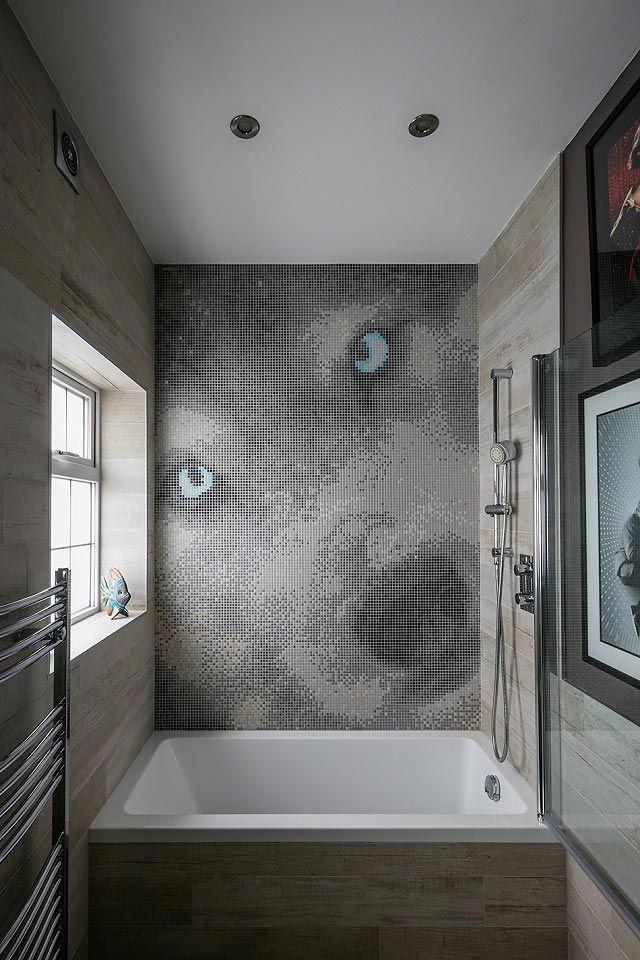 Bespoke Wolf Mosaic Mural in small family bathroom. The bath is a miniature bath that is perfect for kids.