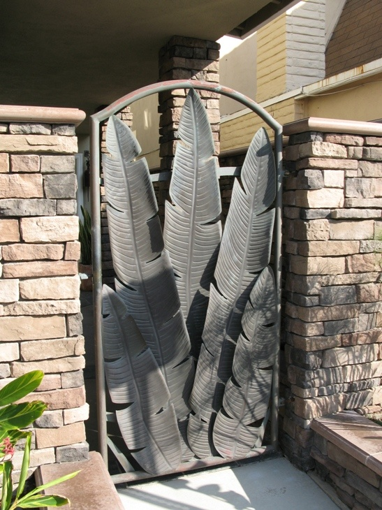 Love this bold and unusual Banana Leaf Iron Gate