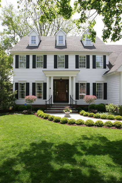 Colonial. This traditional East Coast U.S. style tends to have a symmetrical facade, two stories and a formal entrance front and center.