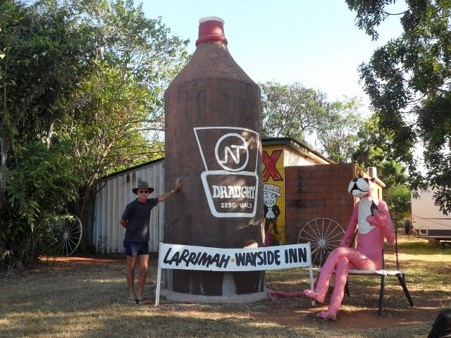 hows this for a bottle of beer and the pink panther sitting next it ,its at the pink panther hotel northern territory