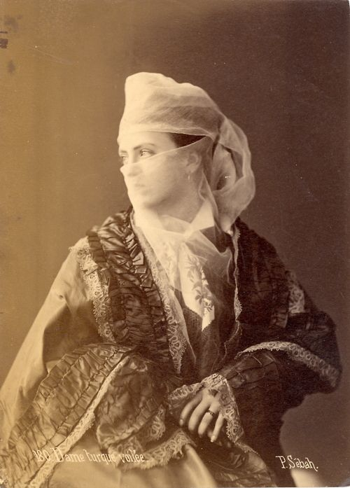 """Dame turque voilée (Veiled Turkish Lady) by Pasqual Sébah (Pascal Sébah), c. 1880-1889 Pasqual Sébah was one of the most important professional photographers of his time in the Ottoman Empire. Today, his works are highly sought after by museums and collectors. Of Syrian or Lebanese origins, Sébah (1823-1886) was a leading photographer in Constantinople, now the city of Istanbul. In 1857 he opened a studio, which he called """"El Chark,"""" next to the Russian Embassy on the Grande Rue de Pera, the…"""