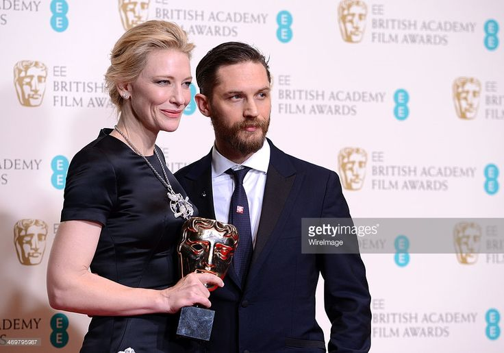 Actress Cate Blanchett, winner of the Leading Actress award, poses in the winners room with Tom Hardy at the EE British Academy Film Awards 2014 at The Royal Opera House on February 16, 2014 in London, England.