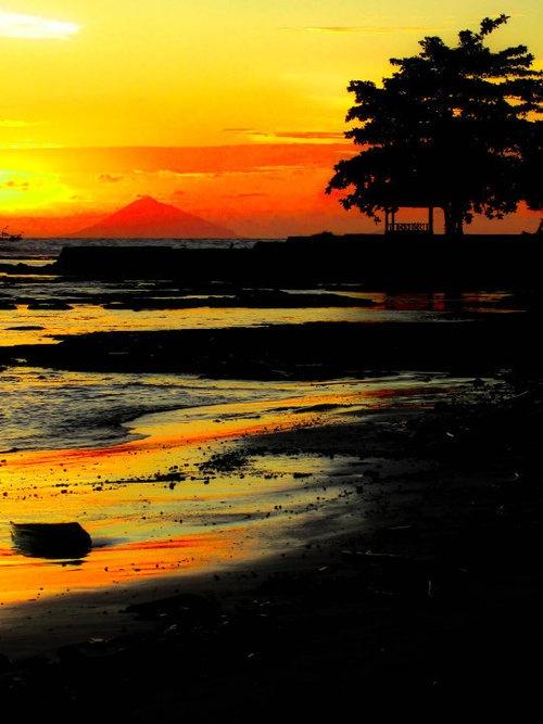 The sun setting over Krakatoa on West Java, Indonesia.