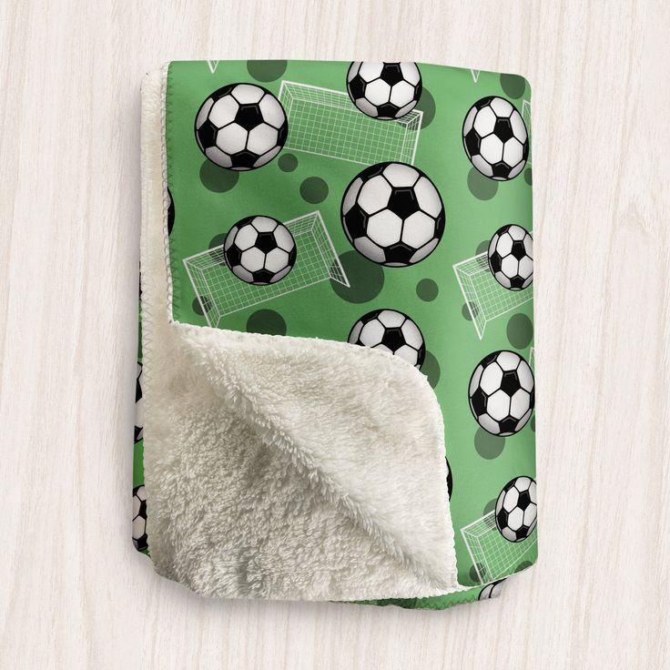 I'm filling up the shop with lots of gifts and goodies like this Soccer Ball and Goal Green Sherpa Fleece Throw.  Visit Speckle Rock: https://specklerock.com, and Pin it to your favorite board. #smallbiz #gifts  | This sports themed Sherpa fleece throw is designed with a soccer pattern with soccer balls over white goal silhouettes and dark green circles, over a green background with a super soft Sherpa material on the other side. It will keep you cozy and warm while you snuggle up in it…