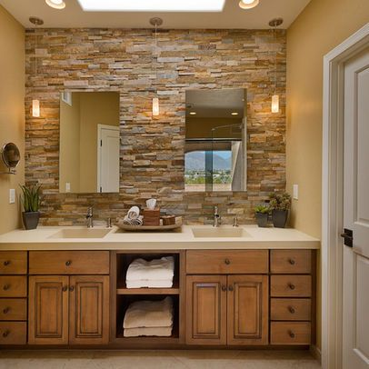 Love the stone feature wall or backsplash in this bathroom. Pretty and organic with wood vanity #bathroom #organicstyle