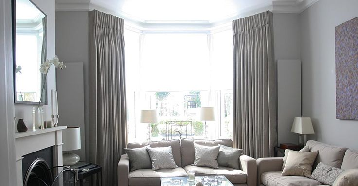 soft grey color curtains for bay windows in living room with soft grey sofa on white wall color. Black Bedroom Furniture Sets. Home Design Ideas